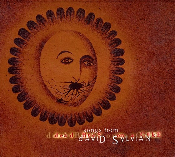 David Sylvian Songs from Dead Bees on a Cake (Promo)Virgin Records 1999 Image by Shinya Fujiwara Art & design by Mills Co-design by Mike Webster