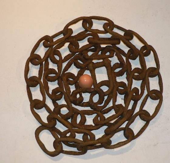 Can See To Can't (Thought Engine) 2008 Rusted chain, wooden egg Dimensions variable