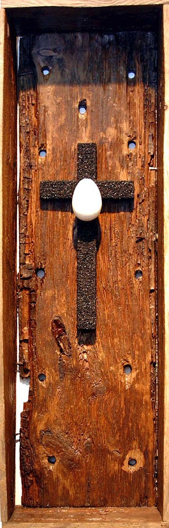 Eclipse (Thought Engine) 2005 Coal-clad crucifix, painted wooden egg, in seed propagation box. 78 x 26 x 12.5 cm