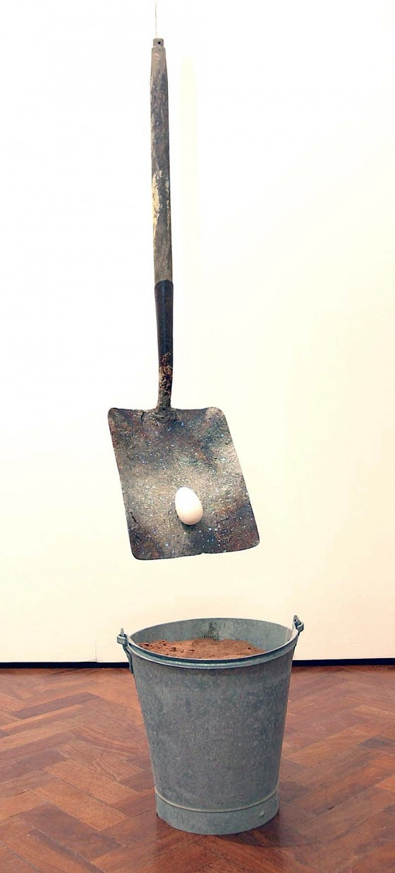 Seed To Star (Thought Engine) 2004 Oils, acrylics, emulsion, cement, ash, glitter, gold leaf, shovel head, painted wooden egg, sand and metal bucket 174 x 30.5 x 30.5 cm